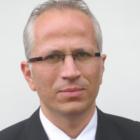 Dr. Ramin Romus